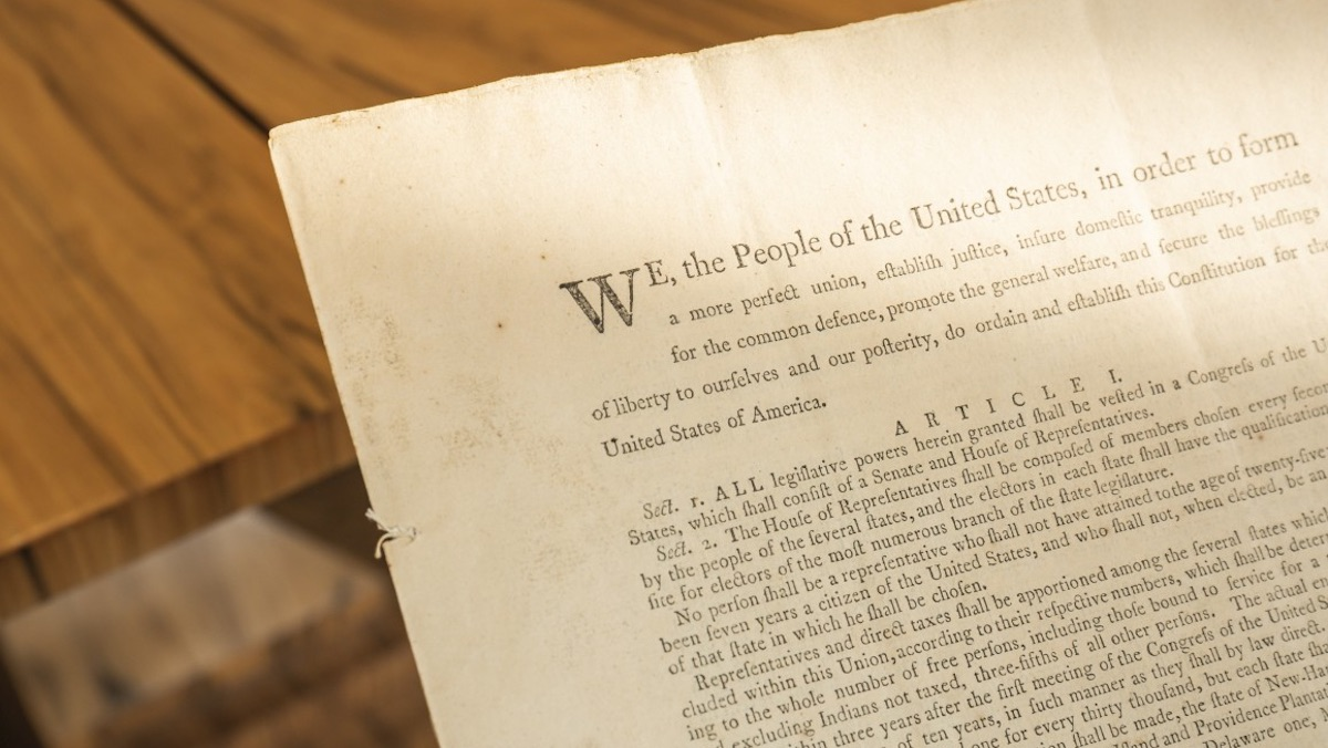 A portion of an original printing of the US Constitution showing the opening text