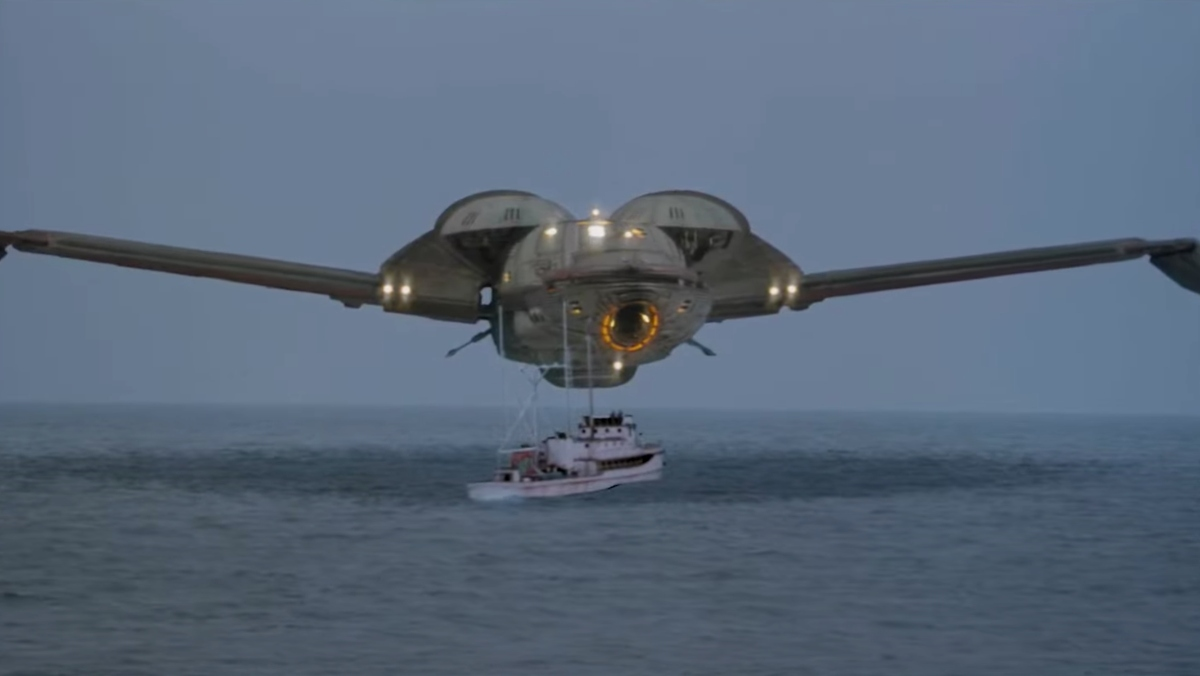 A Klingon Bird-of-Prey hovering above a fishing vessel in the sea in a scene from Star Trek IV. Could the Star Trek ship really have fit two whales?