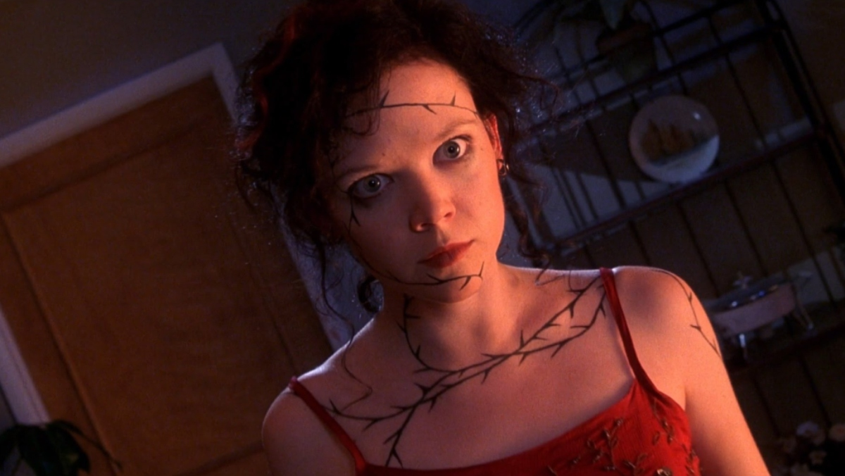 photo of rachel from The Rage Carrie 2 standing with wide eyes and red dress